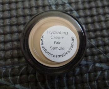 Adorn Hydrating Cream in Fair label